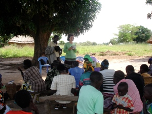 Teaching under the shade of a mango tree.